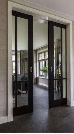 Pocket doors or sliding doors with black trim to offset the rest of the white trim and white fireplace. French Pocket Doors, French Doors, Glass Pocket Doors, Glass Entry Doors, Glass Office Doors, Double Pocket Door, Glass Barn Doors, Entrance Doors, Door Makeover