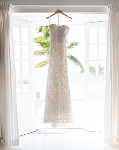 My sister and mom flew to London last fall, and we went to all of the different bridal salons. This Oscar de la Renta dress was one of the first ones I tried on, and I just knew it was the one. I was looking for a dress that was timeless, fit for a wedding on a Caribbean island but also evocative of the quintessential, effortless elegance of a bygone era. The intricate beading and lacework combined with the clean and linear silhouette made for a beautiful dress that felt very me.