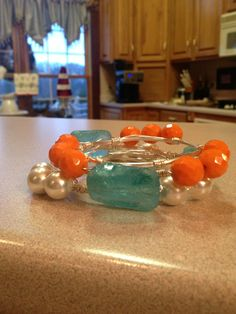 Pearl, sea glass and orange jade!  All on non-tarnished wire. For sale by me, Miss Carribbean!