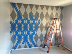 """The Atomic Dad: """"Nesting"""" and the Baby's Room AKA """"How to paint an argyle wall"""""""