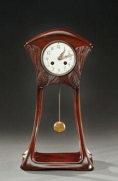 ** MAURICE DUFRENE, Mahogany mantel clock