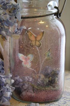 Butterflies, pink gliter, and flowers in a mason jar - Yeah, that's amazing and…