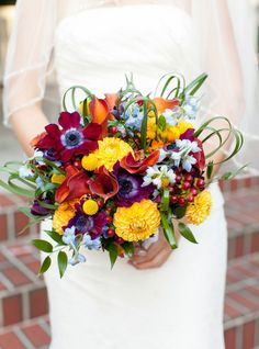 Dahlia, marigolds, anemone, & hypericum berries for a rich autumn wedding bouquet  (flowers by Lee Forrest Design, photo by: Bumby Photography)