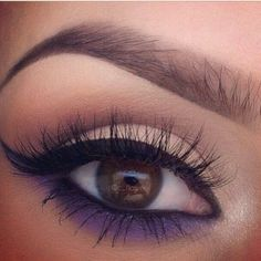 Seeing a lot of cat-eye looks with smokey color under they eye...I like this look.
