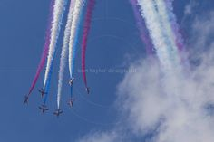 RAF Red Arrows in BAE Hawk T1 trainers Farnborough International Airshow Farnborough Airport Rushmoor Hampshire England  www.alamy.com/image-details-popup.asp?ARef=FC323B  #raf #red #team #jet #airplane #air #plane #display #aviation #airshow #force #hawk #arrows #flight #aerobatic #formation #sky #smoke #aircraft #royal #show #teamwork #military #flying #speed #fast #stunt #british #pilot #wing