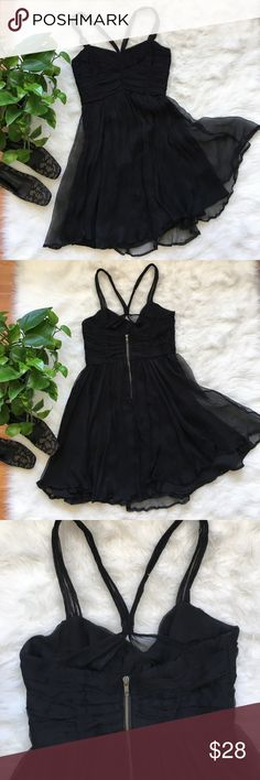 """Anthropologie black silk dress Stunning black silk dress by Lux purchased at Anthropologie. Perfect little black dress for the holidays! Laying flat bust measures 17"""", waist measures 14"""" and total length is 37"""". From a smoke free home Anthropologie Dresses"""