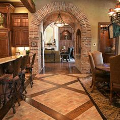 Brick and wood floors, brick archway and walls