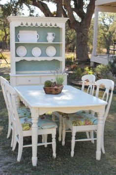 Painted Old White with the back of the hutch painted Duck Egg blue/green, distressed and hand waxed.