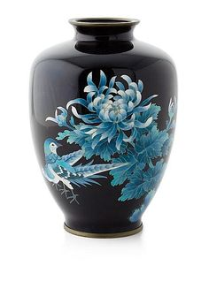 JAPANESE CLOISONNE VASE of baluster form, decorated with blossoming chrysanthemum and birds on a cobalt blue ground 17.5cm high