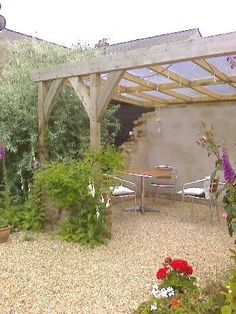Copyright image: Attached lean-to pergola with climbing plants.