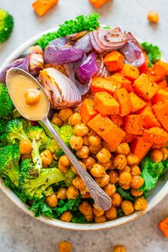 Roasted Sweet Potato and Chickpea Buddha Bowl - A big ole round bowl full of goodness just like Buddha!! The bowls are fast, EASY, naturally vegan and gluten-free! If you need a HEALTHY recipe that tastes like comfort food, this is it!!