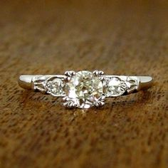 Vintage Engagement Ring with Round Side Stones, circa 1950