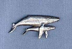 Whale Pin by George Harris. $9.95. Made with surprising detail, each Humpback Whale pin is perfect for men and women. Cast from pewter, a jewelry metal which maintains its antiqued look, and secured with two push-on clasps to prevent rotation, these Whale pins make a great decoration for your jacket, vest, hat, lapel, etc. A great collectible or makes a nice gift for animal enthusiasts. Approximate size on the Humpback Whale pin is 1 3/4 x 3/4 inches.