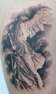 Tattoo of the famous statue Winged Victory of Samothrace at the Louvre by Xavier Garcia Boix