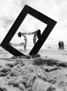 Super cute idea! Took one of my old frames out to the beach with my friend. My fav pic right now