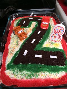 Cars cake - Crushed Oreos for the road, worked great but regular frosting lines didn't stick to the road, freezing the frosting didn't work, would leave it out to harden next time