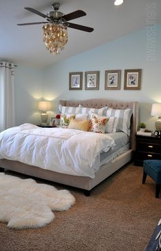 Great master bedroom redo - I love the way she made over the ceiling fan. IT is so essential for me but she put a chandy from World Market over the lights. Brilliant!