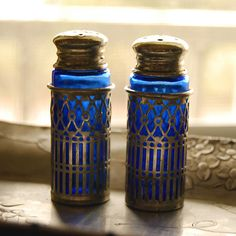 Cobalt depression glass salt and pepper shakers    These vintage lovelies are cobalt depression glass covered by silver plate filigree