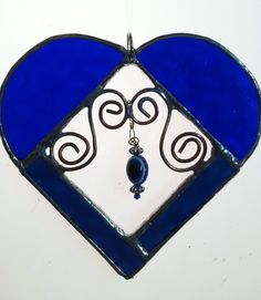 cherished, stained glass heart with twisted copper wire and hanging glass beads. $26.00, via Etsy.