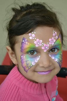 .pretty face paint idea for girls butterfly mask with flowers in a soft pearl rainbow