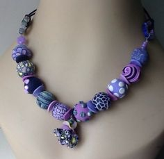 A personal favorite from my Etsy shop https://www.etsy.com/listing/192236736/purples-lavender-orchid-statement
