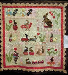 "Here is a gorgeous ""Rabbits Prefer Chocolate"" quilt by Fleda Gorbea, also shown at the 2013 Arizona Quilters' Guild show.  She says:  ""I had a lot of fun picking out my fabrics and trips for this Anne Sutton pattern [Bunny Hill Designs]. My cat's name is Coco and nicknamed Bunny, thus the name change""."