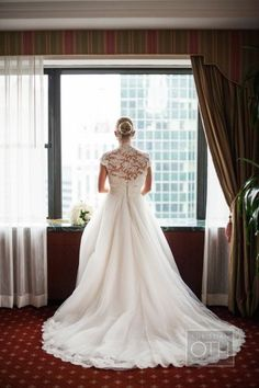 This Anne Barge bride added a beautiful lace bolero to her ensemble for the ceremony.