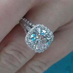 Beauty.Absolutely gorgeous!!!! I love the wide band up towards the center stone!!!! And cushion cut!!!!