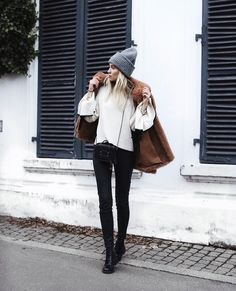 Cream top, black skinny jeans, brown faux fur coat, grey beanie, black boots & small shoulder bag | @styleminimalism