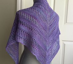 Show off your favorite hand dyed yarn with this sweet + simple triangular shawl.