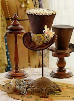 Lovely brown top hats on the prettiest hat stands!  (Is this from a Halloween Alice/Mad Hatter Party in a Halloween Magazine from last year?)
