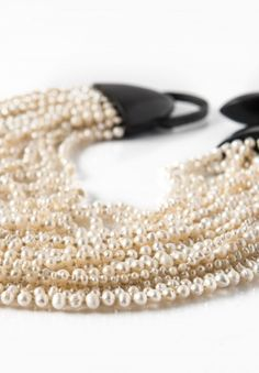 $1,495.00 | Monies UNIQUE Cascading Small Pearl Necklace | Monies jewelry is bold in design and strong in aesthetic. This Monies necklace is made with Pearls, Ebony, and Leather, to become a one-of-a-kind and edgy statement piece. All pieces are handmade. Monies is sold online and in-store at Santa Fe Dry Goods & Workshop in Santa Fe, New Mexico.