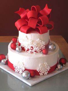 For a Christmas themed wedding.  This is my first (and probably last!) wedding cake.  Both tiers are WASC with cookies  cream filling.  Bow  ribbons are fondant, Christmas ornaments are real.  I drew lots of inspiration from cakes here on CC, particularly one from citygirlcakes.