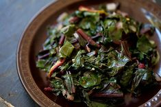 Beet Greens by simplyrecipes: Greens sauteed with bacon, garlic, onion, crushed red pepper flakes, sugar and cider vinegar. This also works well with kale or collard greens! #Greens #Beet_Greens #simplyrecipes