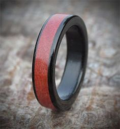 Made from sustainable woods sourced from the heart of Africa, this wooden engagement ring has been exquisitely handcrafted bringing together Ebony and Pink Ivory, two incredibly strong woods. You can find out more about this wooden ring www.wooden-rings.com