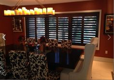 "Shutter installation by Budget Blinds of Coral Gables. 4 1/2"" louvers, Color: Wenge [Norman] with invisible tilt."