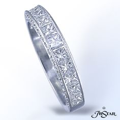 Style 1516 Gorgeous multi-row diamond band handcrafted featuring princess diamonds with round pave on the side. Platinum.
