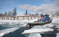 """A tugboat breaks up ice in Burnham Harbour near the Loop in Chicago, Illinois"" Photo credit: Scott Olson/Getty Images (via Telegraph.co.uk)"