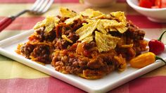 Dig into family-pleasing casserole packed with ground beef, tortillas, refried beans and rice. Olé!