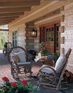 Rustic porch  I would dearly love to have chairs like those