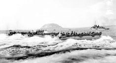 U.S. Marines aboard a landing craft head for the beaches of Iwo Jima Island, Japan, on Feb. 19, 1945... - Joe Rosenthal/AP