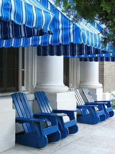 Adore these blue striped awnings, and fab Adirondack chairs.great looking combo of blue and white! Love Blue, Blue And White, Bleu Indigo, Color Azul, Something Blue, White Decor, Modern Interior Design, My Favorite Color, Porches