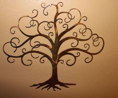 Swirled Tree of Life Metal Wall Art Decor by HGMW. $26.99, via Etsy.