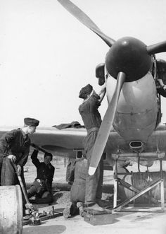 """Ground staff service a Spitfire Mk I of No 610 Squadron RAF at RAF Biggin Hill in September 1940. The turn-around time of rearming and refuelling a Supermarine fighter on the ground was generally 26 minutes, while the Hurricane Mk I was usually finished in 9 minutes from down to up again. As one fitter of No 145 Squadron RAF quipped, """"If we had nothing but Spits we would have lost the fight in 1940."""""""