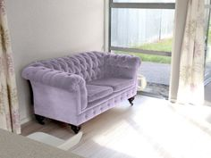 My vintage baby Chesterfield sofa. Re-coloured to Dulux Cape Palliser.
