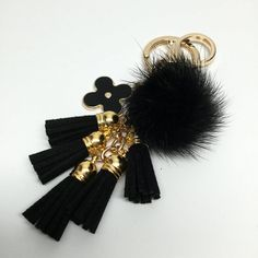 Beautiful Genuine Mink Fur Pom Pom Creation from YogaStudio55  Mink fur ball plush key-chain comes with our high quality hardware + flower charm and 5 cute suede tassels    DESCRIPTION:  Full of personality, this playful fur key chain is at once whimsical and chic.   Featuring a ring and clasp hook for your keys or handbag, it adds an instant dose of cool to any of your accessories.  Use as a key chain, favorite handbag ornament, car key chain ..    This pom pom is made out of genuine mink…