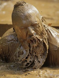 A participant emerges from the mud at the Bluegrass Mud Run, Lexington, Kentucky, America