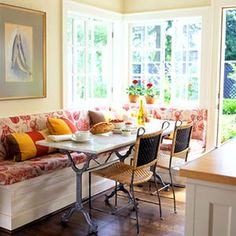 I wish I had an light, open Dining Nook like this.