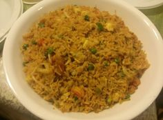 Shrimp fried rice: peas, onions, cabbage, bean sprouts, mushroom, fried shrimp, fried eggs, pre cooked rice. Seasonings: Soy sauce, ginger paste, sesame oil, fish sauce.