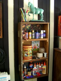 older and wisor: How To Create A {Budget} Craft Room - Love this drawer turned sideways, the way she stores thread in a typeset tray (have one) and the strange wooden thing that holds wrapping paper, I'm sure I could replicate something